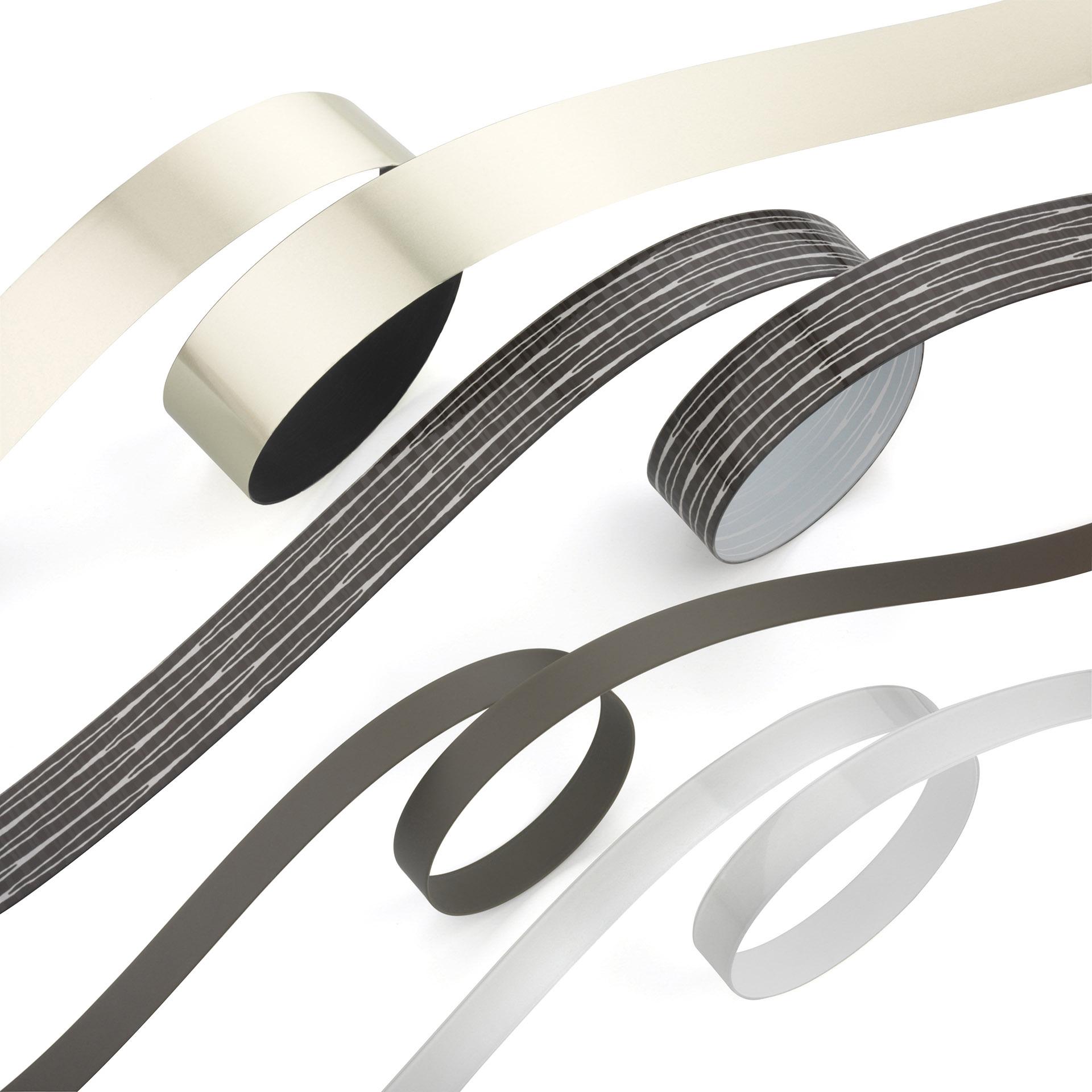 Detailaufnahme Kantenumlaufbänder in Silber, schwarz, weiß und schwarz strukturiert. Feigfotodesign